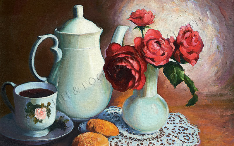 Bright red flowers in a white vase